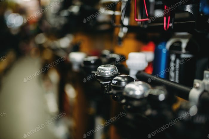 Bicycle equipment shop, new bike bells closeup