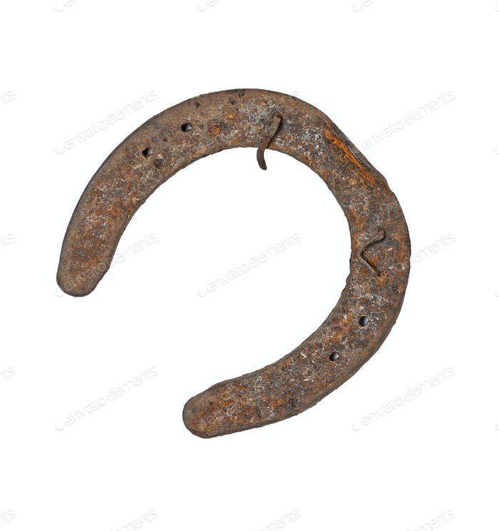 Rusty horsehoe on white background