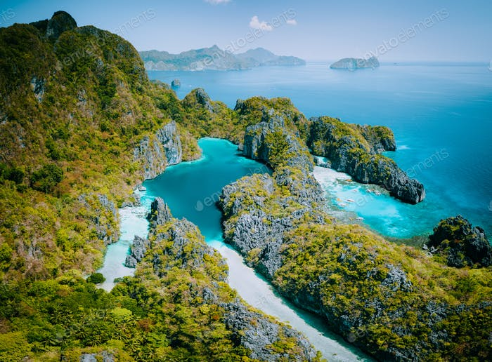 Palawan, Philippines aerial drone view of turquoise lagoon and limestone cliffs. El Nido Marine