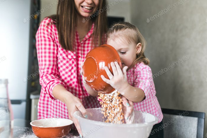 Thumbnail for Mom and daughter together in the kitchen