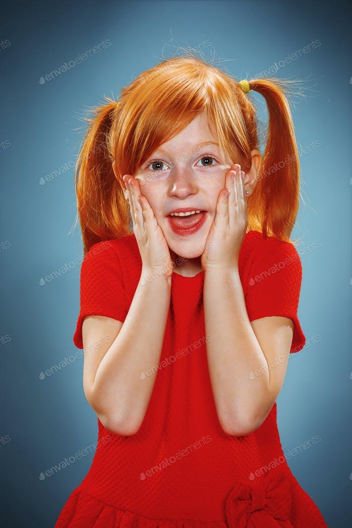 Beautiful portrait of a surprised little girl