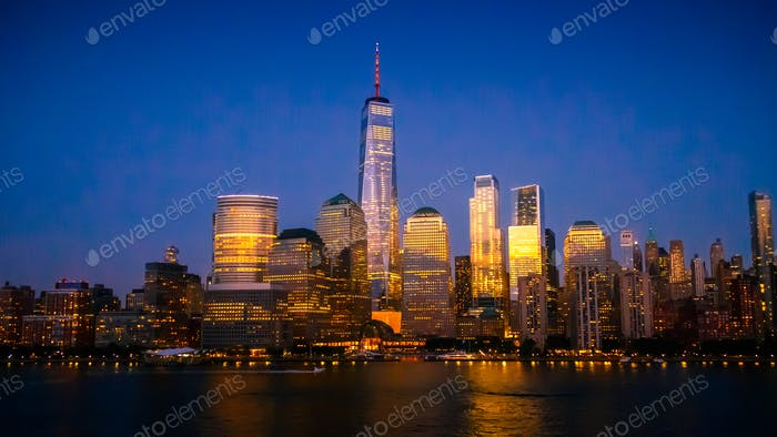New York City Skyline with Skyscrapers Illuminated at Dusk