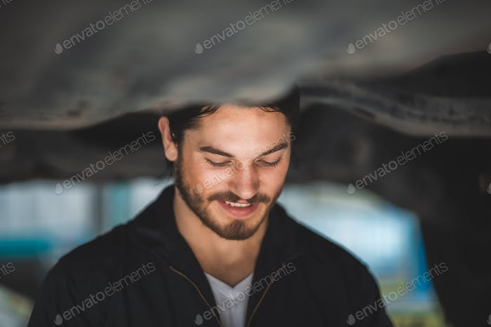 mechanic car service worker man technician are maintenance or repair vehicle car engine