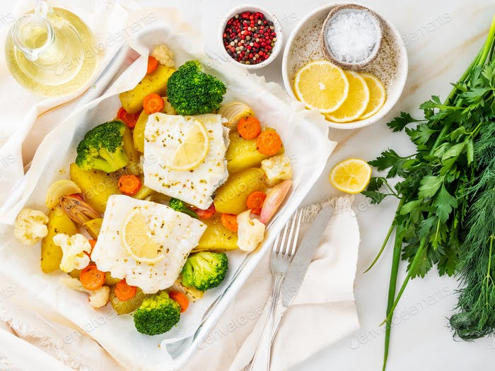 Fish cod baked in the oven with vegetables - healthy diet healthy food. Light
