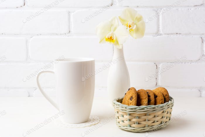 White coffee cappuccino mug mockup with soft yellow orchid in va
