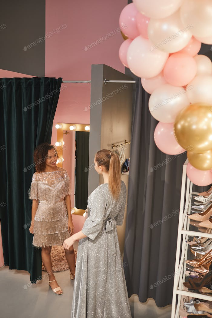 Young Women Trying on Gowns in Boutique