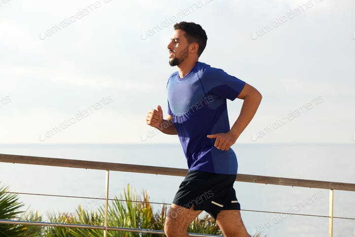 healthy young male running outside