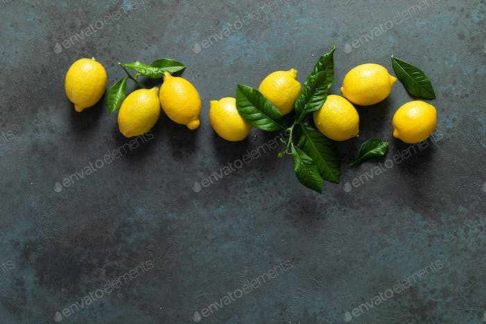Fresh lemons with leaves, summer citrus lemonade ingredient