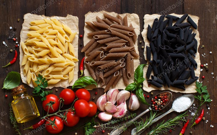 Penne pasta with vegetables,  herbs and olive oil