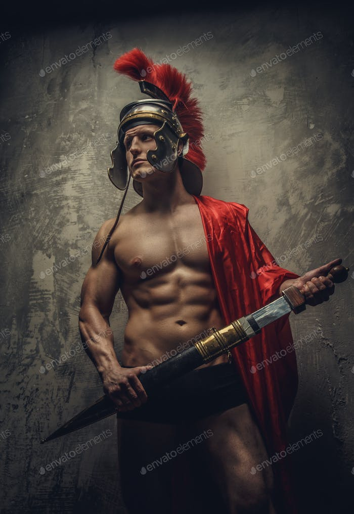 Shirtless muscular man in roman armour.