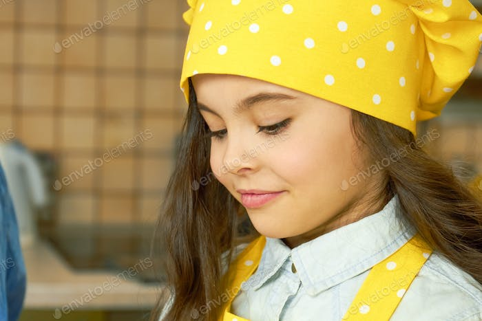 Girl in chef hat