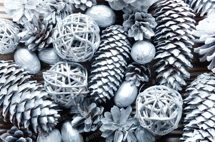 Flat lay silver background of fir and pine painted cones, nuts a