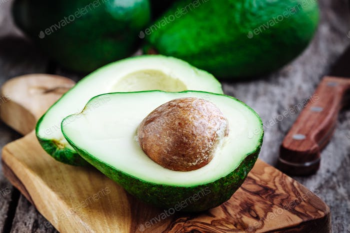 Fresh raw organic avocado on a wooden background