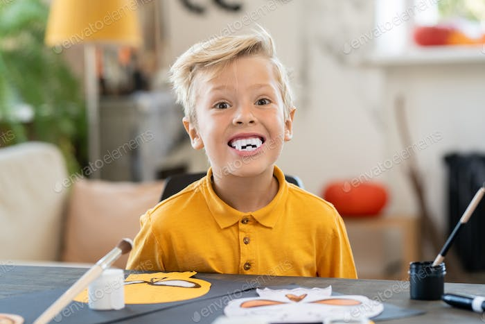 Boy with fangs preparing for Halloween