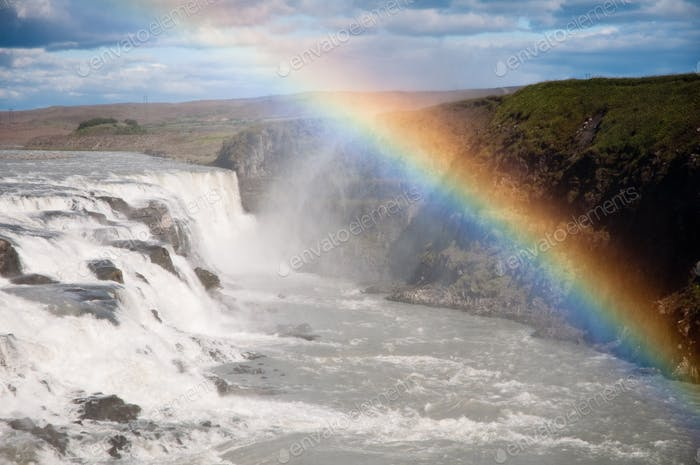 waterfall with beautiful genuine rainbow