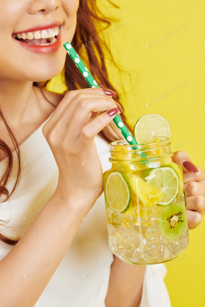 Woman with non-alcoholic drink