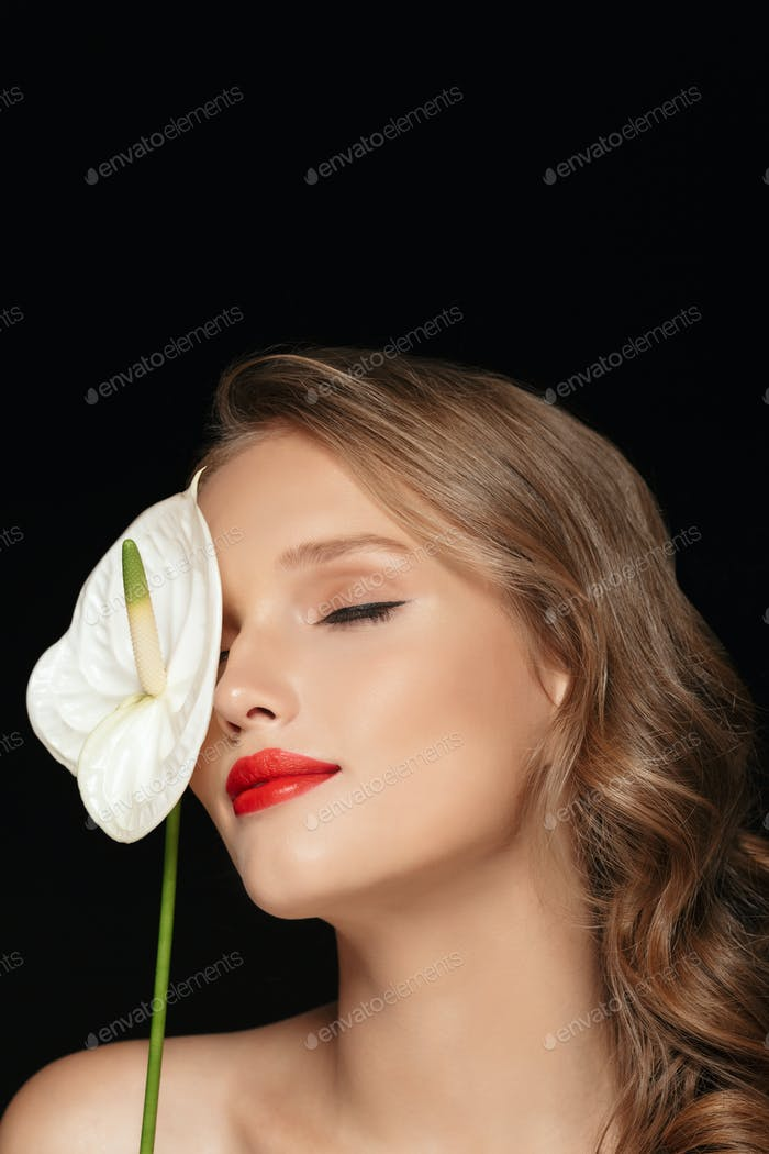 Portrait of young attractive lady with wavy hair and red lips dr