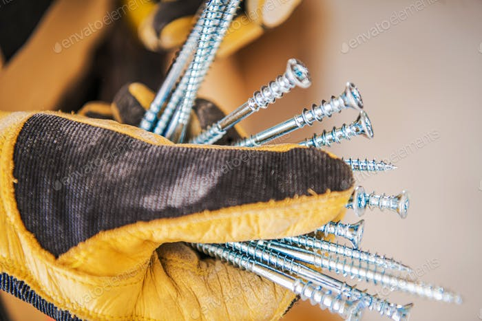 Construction Screws in Worker's Hand