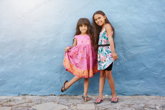 Two happy little girls posing together