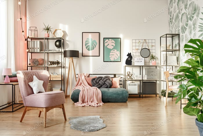 Pink armchair in cozy bedroom