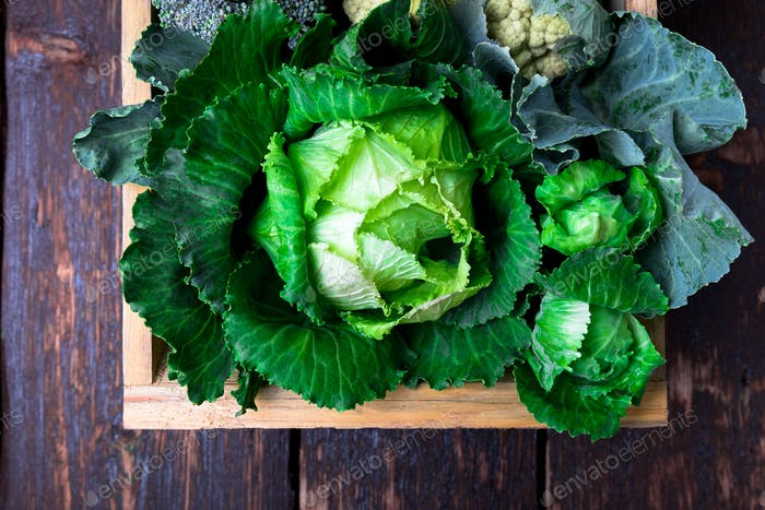 Variety of cabbages in wooden basket