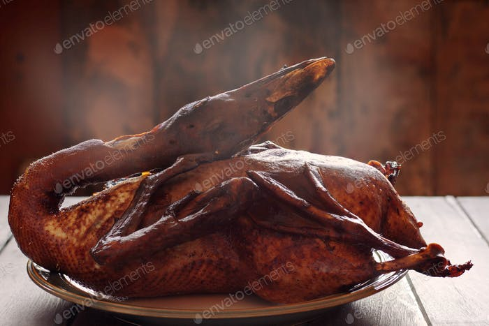 Roast duck on table