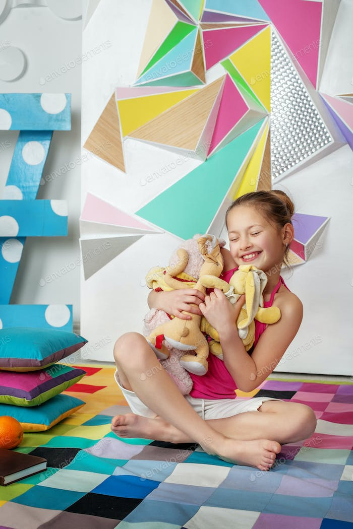 Child playing toys and hugs. The concept of childhood and play