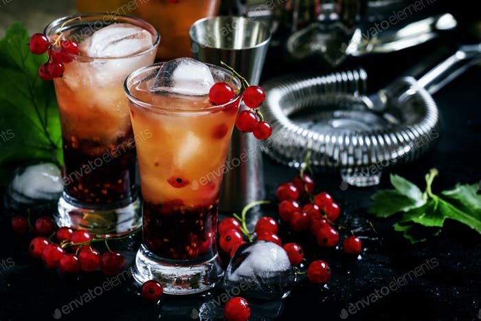 Alcoholic cocktail summer fizz with orange and redcurrant