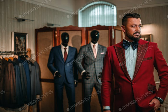 Extravagant stylish man in tailor studio.