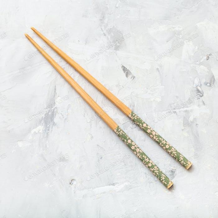 wooden chopsticks on concrete board