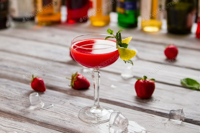 Bright red cocktail in glass