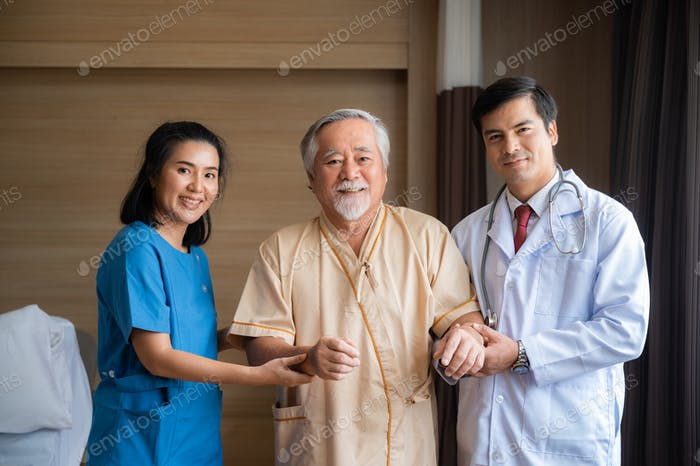 Medical professionals examining the health of the elderly male patient