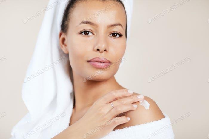 Beautiful Woman Applying Body Cream