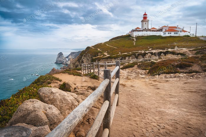 Sintra Portugal. Cape Roca and red lighthouse. Cabo da Roca. Travel and tourism landmark with
