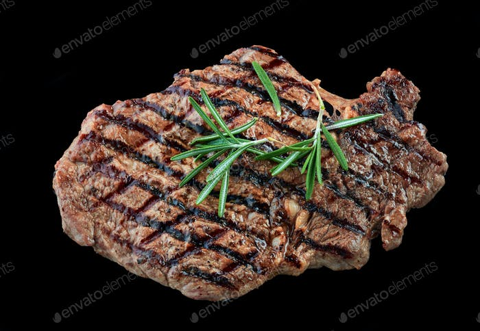 grilled beef steak meat on black background