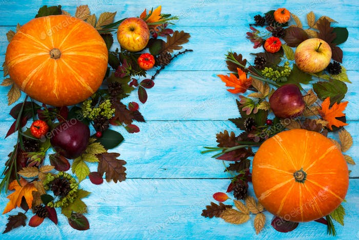 Thanksgiving greeting with leaves and pumpkin on blue wooden tab