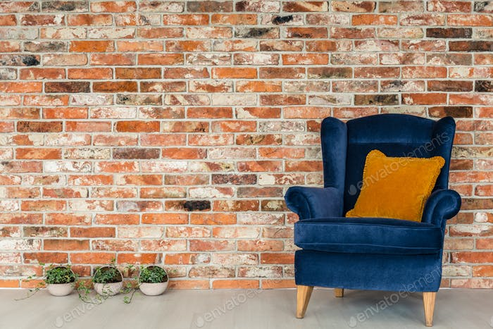 Armchair with orange pillows