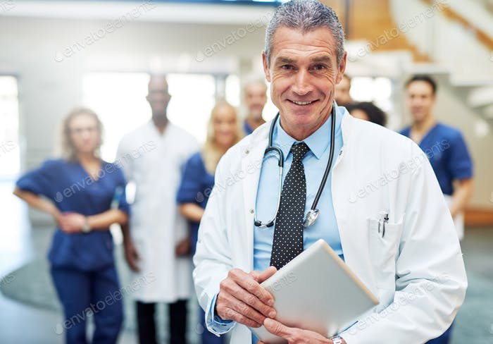 Adult man in doc uniform with tablet