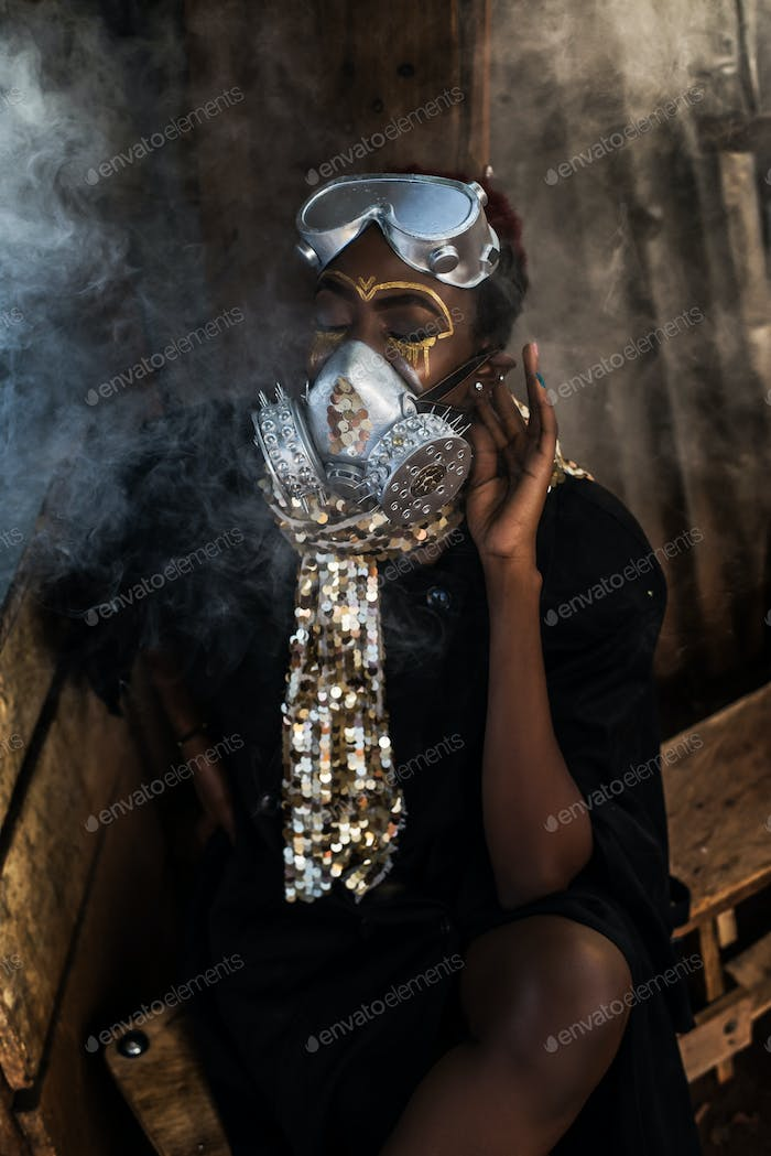 Potrait of a  black woman putting on a mask