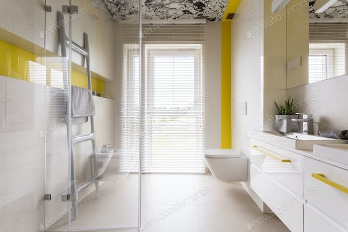Luxury bathroom with yellow details
