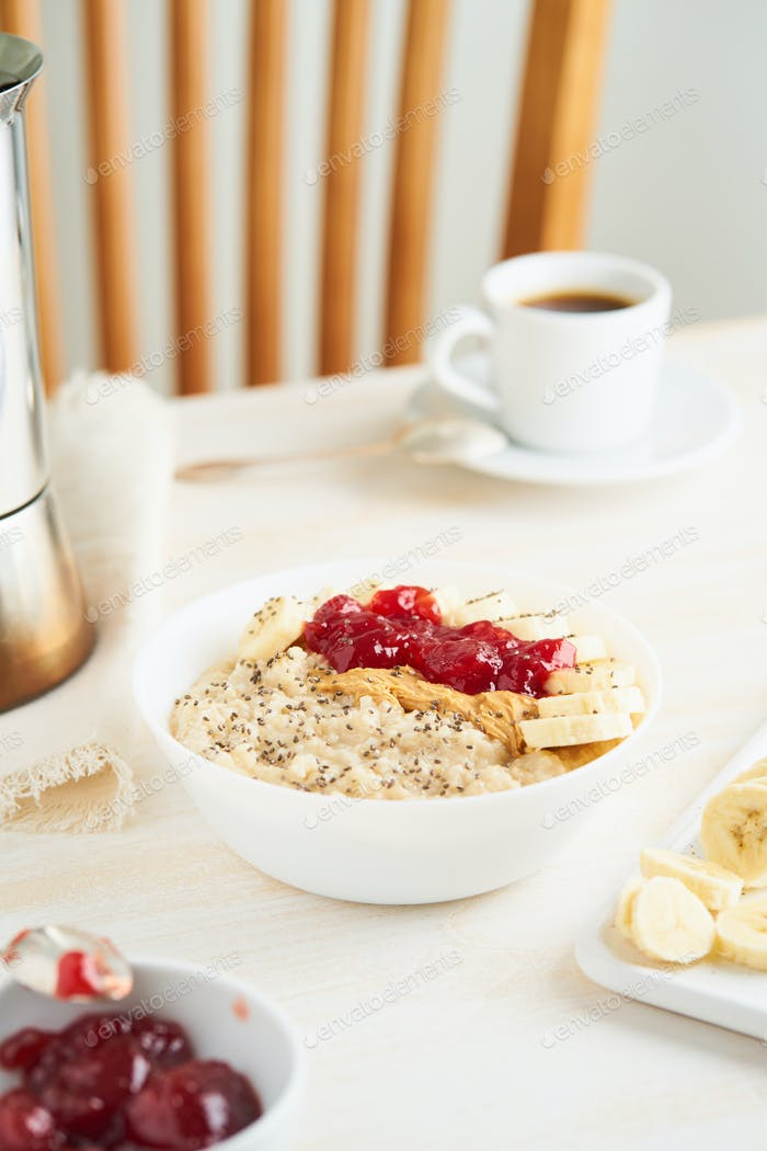 Oatmeal with strawberry jam, peanut butter, banana, Chia