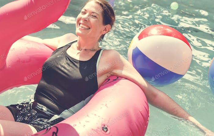 Woman enjoying the water in a swimming pool