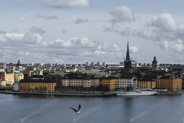 River by Gamla stan against sky