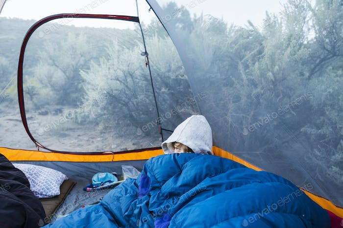 6 yera old boy waking up in tent