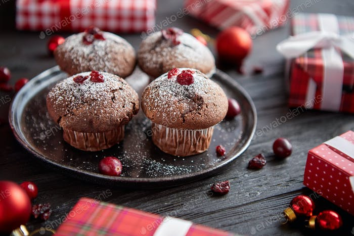 Christmas chocolate delicious muffins served on black ceramic plate
