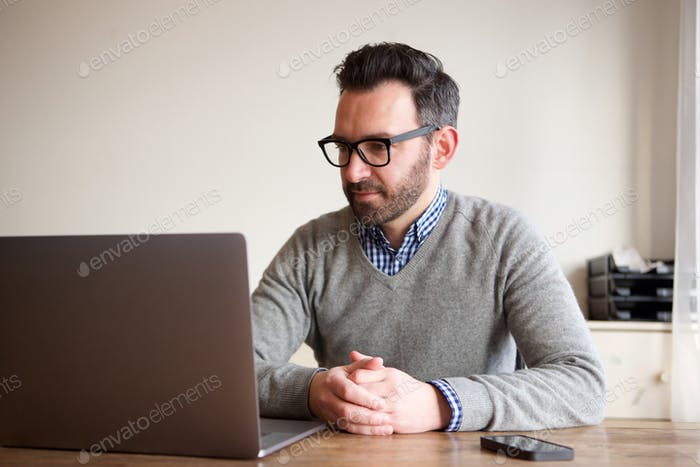 middle age man working on laptop at home
