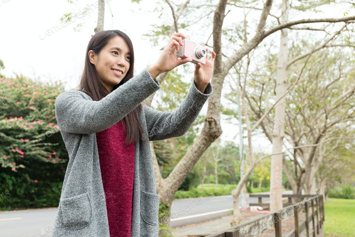 Young woman use of the digital camera for sightseeing