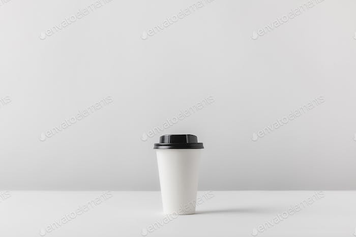 disposable coffee cup on white tabletop