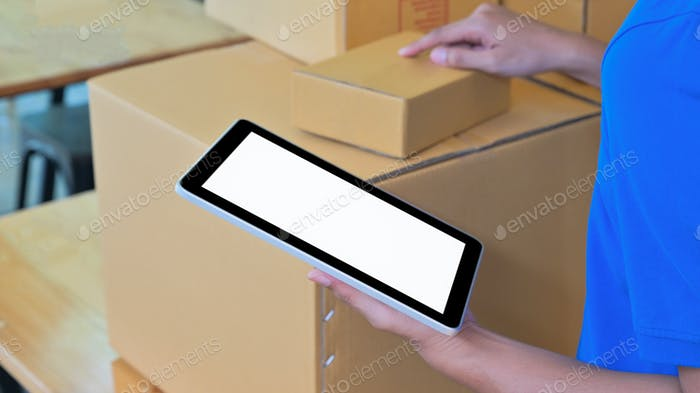 Courier using a digital tablet to verify customer information.