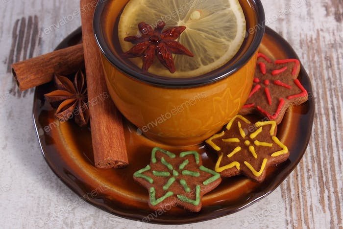Cup of tea, gingerbread and spices, christmas time concept